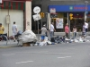 poor people crawling the garbage on the street